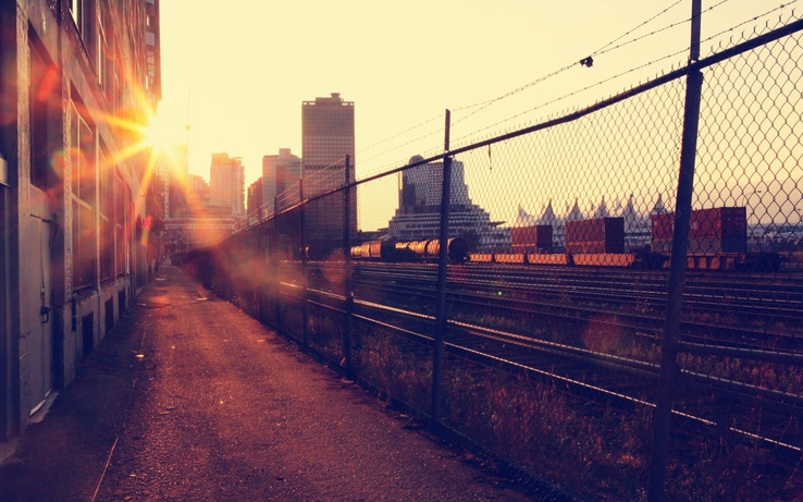 1373482-cityscapes,Vancouver,sunlight,railroad tracks,macro,chain link fence,cities.jpg