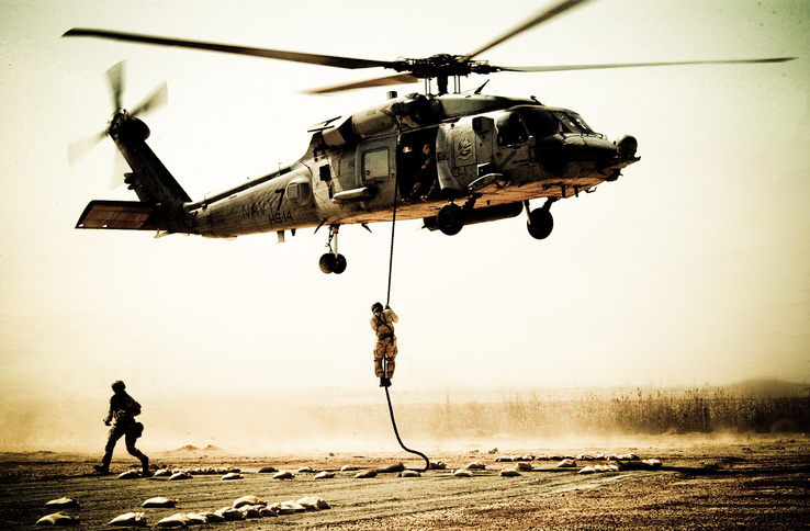 487858-soldiers,aircraft,army,military,helicopters,vehicles.jpg